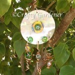 garden bling from old cds, wire and marbles at craftygardener.ca