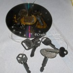 a key chime from old cds, wire and marbles at craftygardener.ca