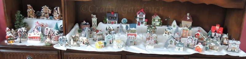 the Christmas village on the china hutch at craftygardener.ca