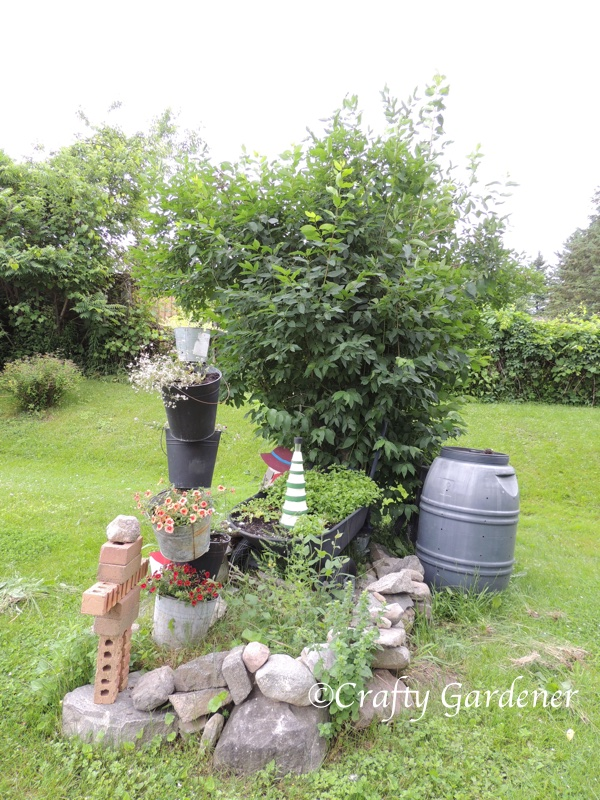 an inuksuk made of bricks at craftygardener.ca