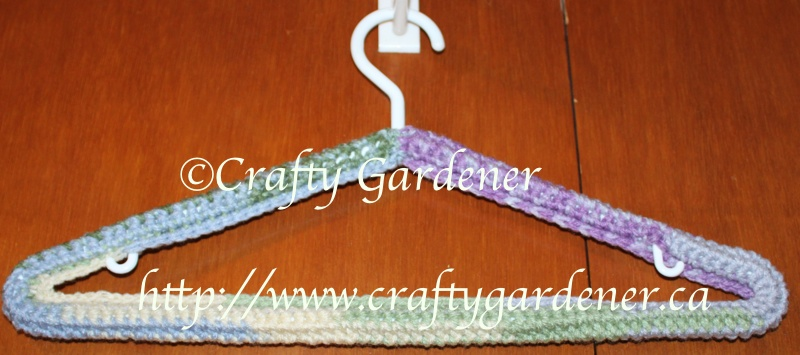 covering coat hangers with a long crochet strip at craftygardener.ca