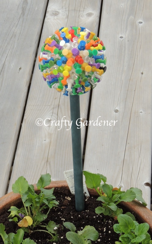 a plant poke made from a styrofoam ball and push pins at craftygardener.ca