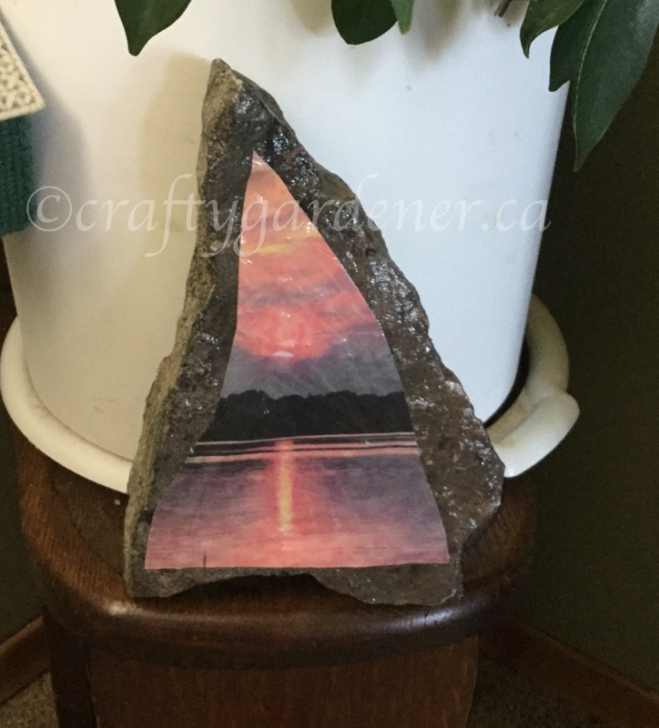 a sunset photo decoupaged onto a rock at craftygardener.ca