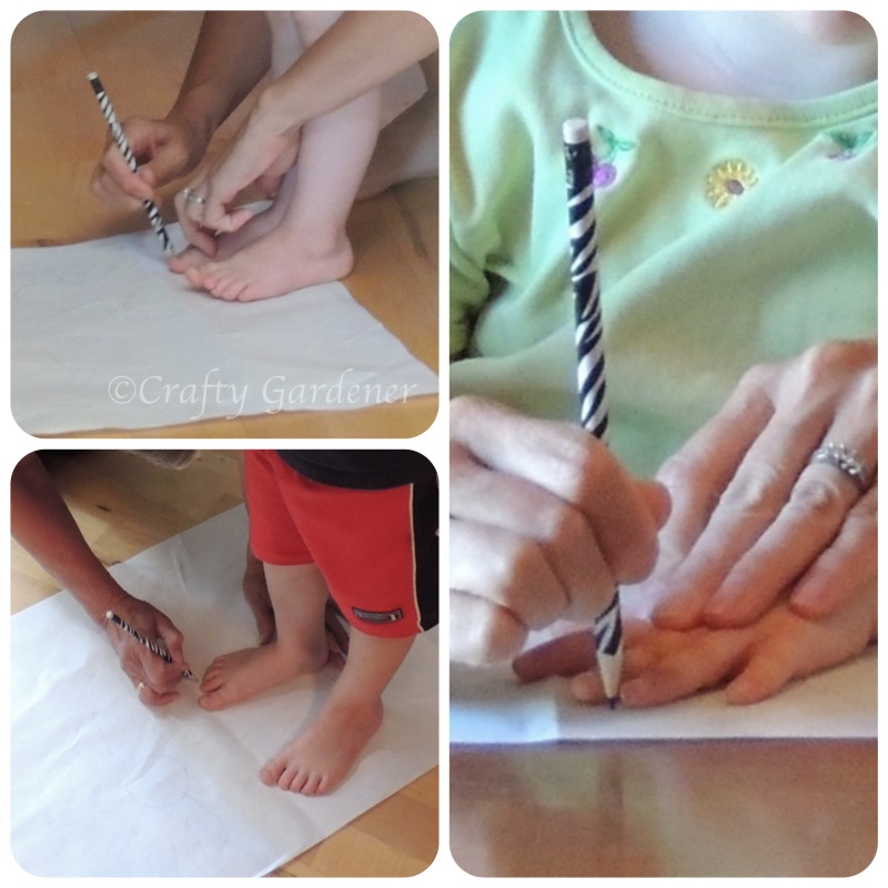 tracing hands and feet to make a garden flag at craftygardener.ca