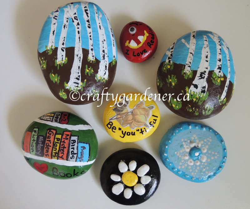how to make a pebble art daisy at craftygardener.ca