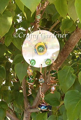 garden bling from old cd's, copper wire, flat gems and marbles at craftygardener.ca