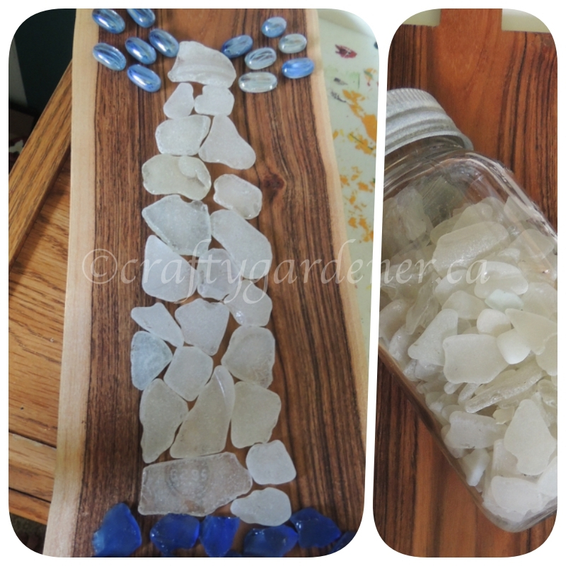 a lighthouse made with seaglass at craftygardener.ca