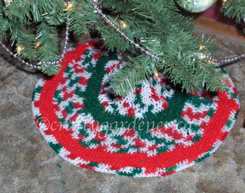 a tree skirt made using the shoulder snuggle pattern at craftygardener.ca