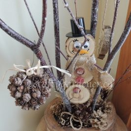 making a snowman out of wood slices at craftygardener.ca