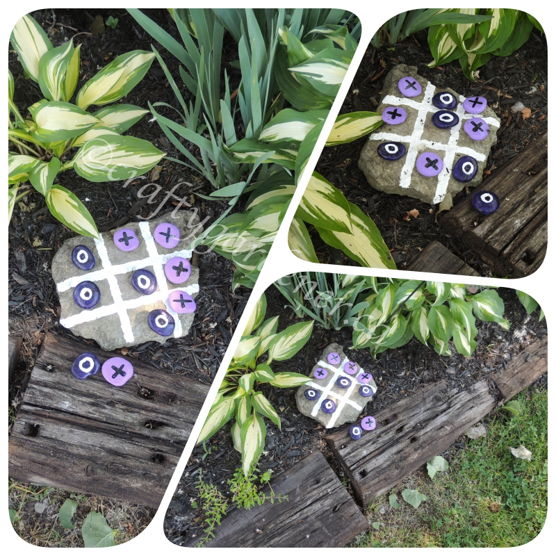 a tic tac toe game made with rocks at craftygardener.ca